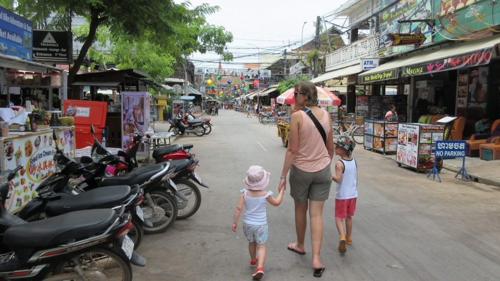 Amber, Ned and Olive  from Hill Tribe Travels wondering Pub Street, Siem Reap during the day whilst exploring Siem Reap with Kids