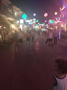 Olive loving the lights and action along Pub Street at night