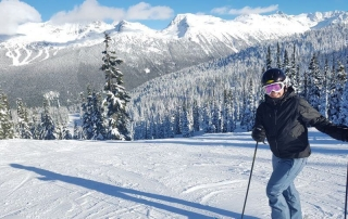 Beautiful WhistlerBlackcomb - HIll Tribe Travels - Top tips for skiing with kids in Canada - at the top of a run taking in the scenery before heading down the run