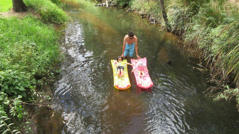 Ned and Olive loving floating down the river at Glen Cromie