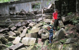 HIll Tribe Travels finding our own path at Beng Mealea by scrambling over rocks - so much fun whilst exploring Angkor Wat and surrounding temples with kids