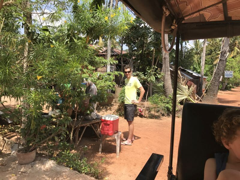 Ross from Hill Tribe Travels waiting to sample some different fruit. On our temple alternative tour in Siem Reap with Dani from Bees Unlimited