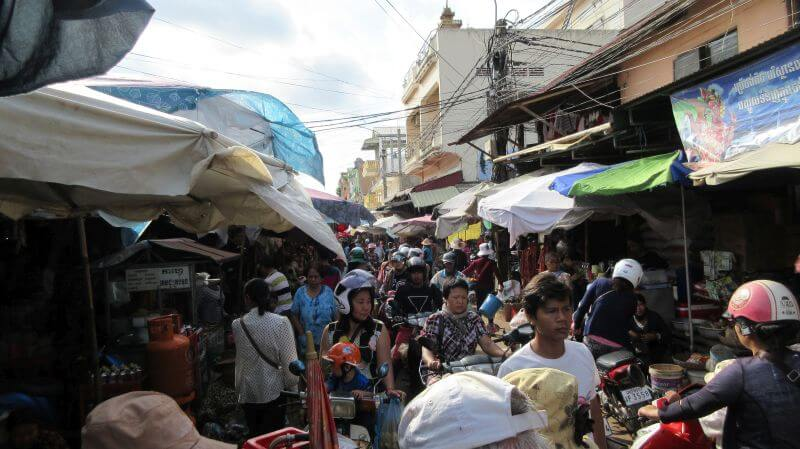 The craziness of the local market in Siem Reap. People and motorbikes everywhere. Hill Tribe Travels visited this market on our Template Alternative Tour in Siem Reap with Bees Unlimited.