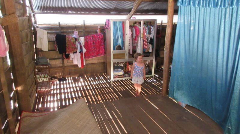 Upstairs of a local house - very neat and tidy with clothes hanging up - Hill Tribe Travels visited on temple alternative tour with Bees Unlimited