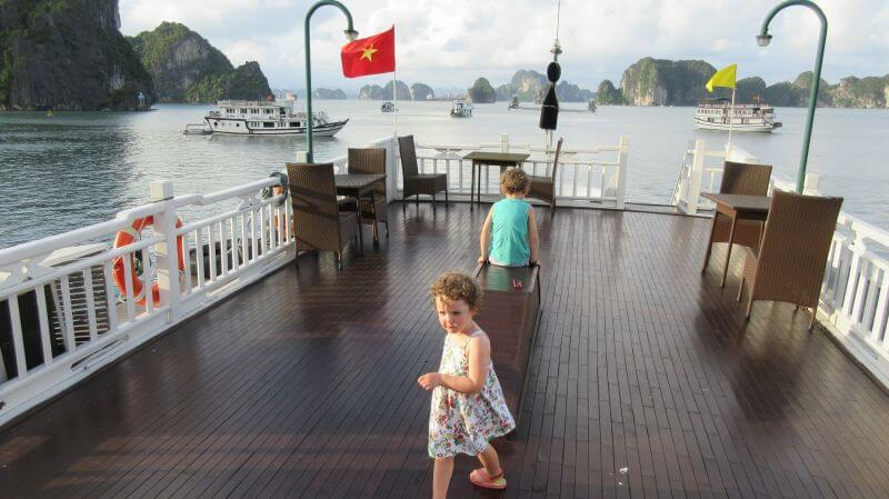 Ned and Olive from Hill Tribe Travels having a run around on the top deck of our Bhaya Cruise around Halong Bay with kids