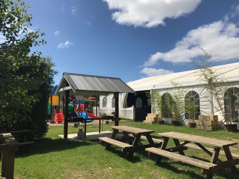 Picnic area and Dinosaur themed playground at Dinosaur World in Somerville - Hill Tribe Travels visited before Christmas