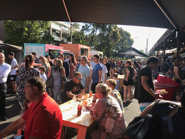 The crowds of people at the South Melbourne Night Market