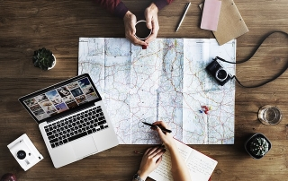 Map, and laptop to plan family travel