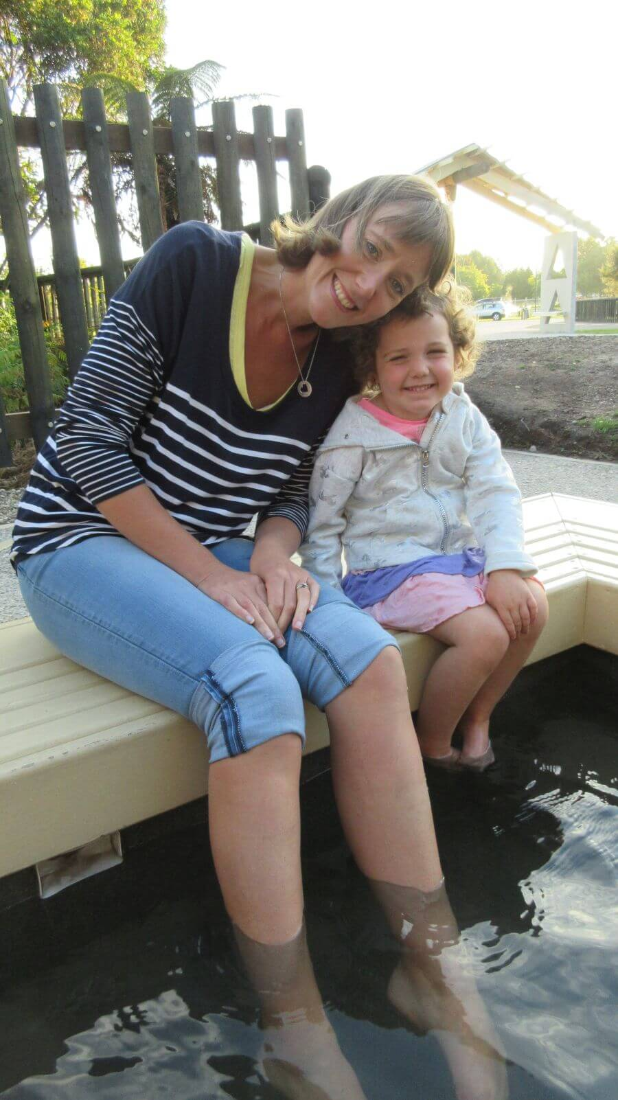 Amber and Olive from Hill Tribe Travels enjoying the free foot bath whilst in Rotorua with kids adventure