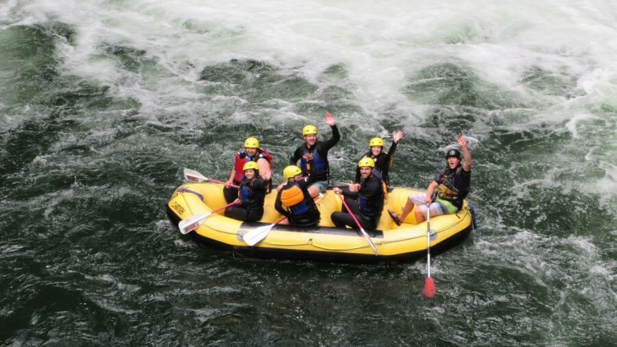 Rafters after going down Okere Falls in Rotorua with kids - Hill Tribe Travels