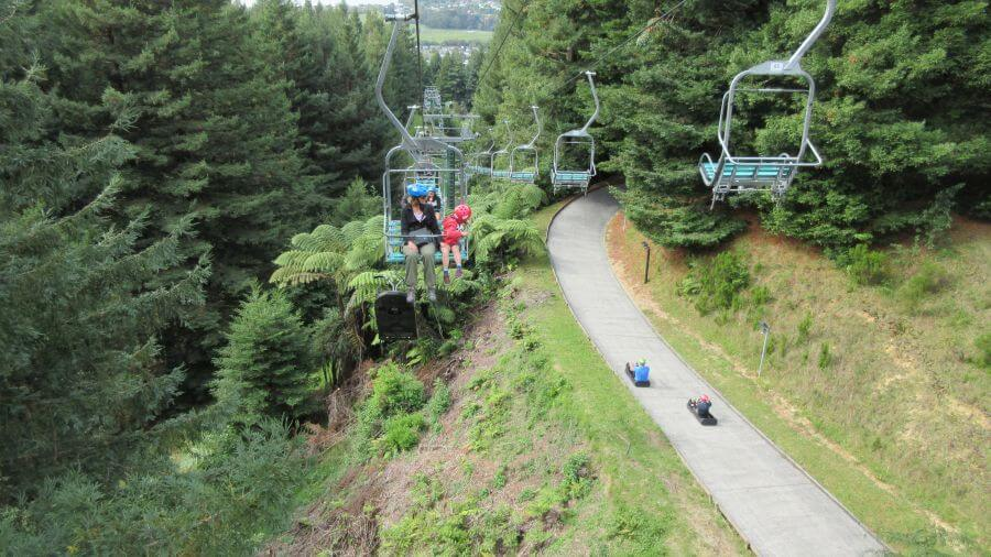 Hill Tribe Travels Riding the chairlift, watching the luge! At Skyline Rotorua - Rotorua with kids