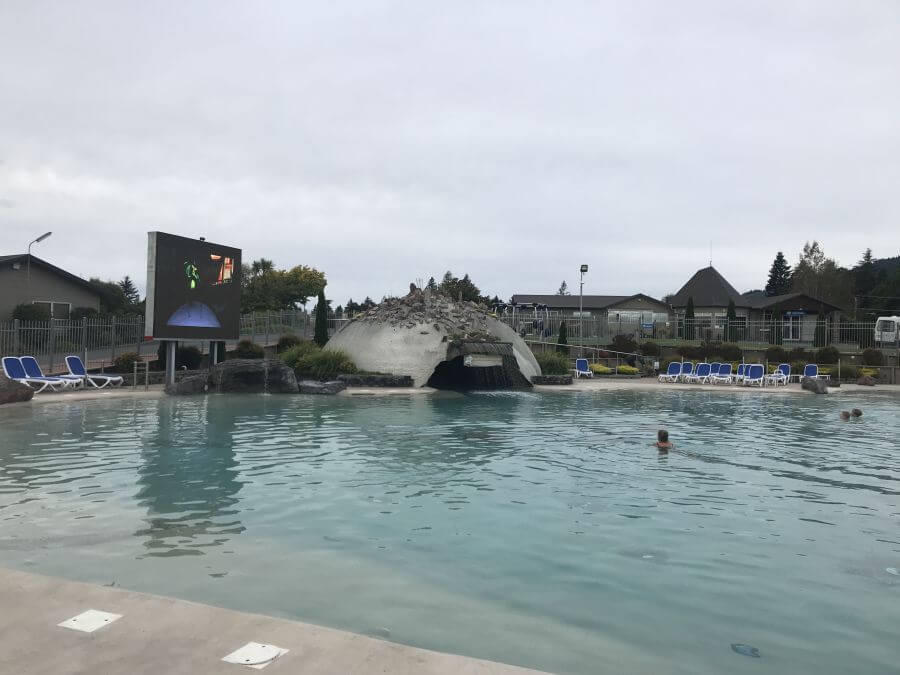 Lake Taupo Holiday Resort's pool with big screen, cave, swim up bar all geothermal heated.