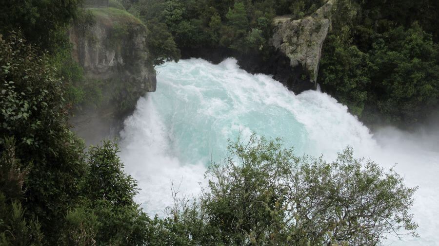 Huka Falls - loads of water falling. Hill Tribe Travels visited whilst going on an adventure around New Zealand with kids
