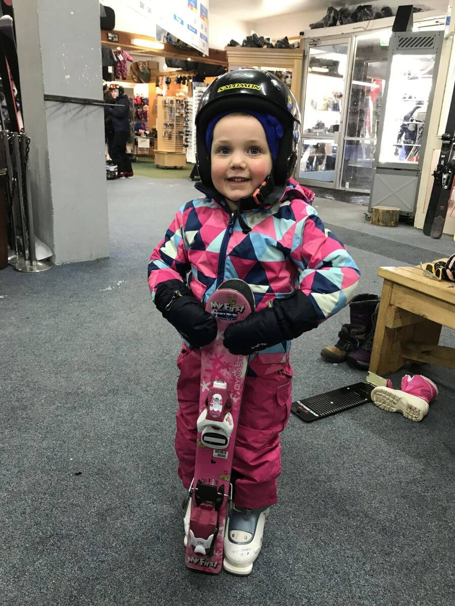 Olive from Hill Tribe Travels all ready to ski. You can see here how she has proper pants, jacket, beanie and gloves.