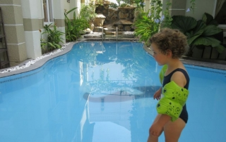 Olive from Hill Tribe Travels looking into the pool. This is our review of the Garden Villa Homestay in Hoi An