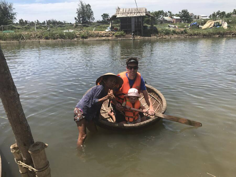 Hill Tribe Travels using a traditional boat on their Heaven and Earth bike tour of Hoi An. This is a review of the Heaven and Earth countryside tour