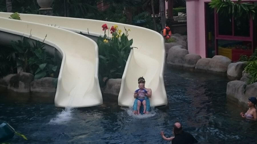 Olive and Ross from Hill Tribe Travels enjoying the water slide at Grand Centara Beach Resort