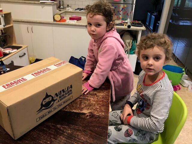 Ned and Olive from Hill Tribe Travels waiting to open the box which contains their Ninja Masks. Hill Tribe Travels reviews the Ninja Full Face Mask