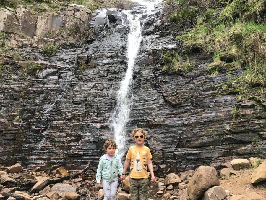 Ned and Olive from Hill Tribe Travels standing at the bottom on Silverband Falls. A great walk for kids in The Grampians