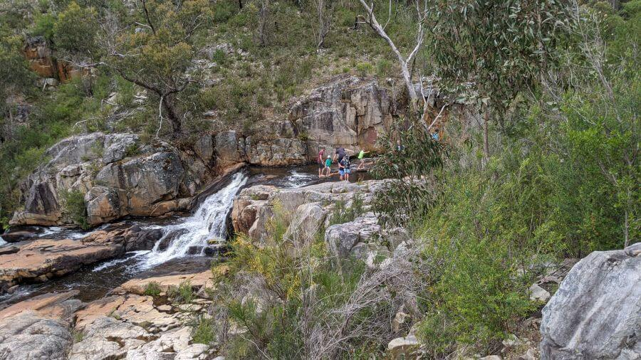 Wetting our toes at Fish Creek Falls. Hill Tribe Travels visited Fish Creek Falls as part of investigating best walks for kids in the Grampians.
