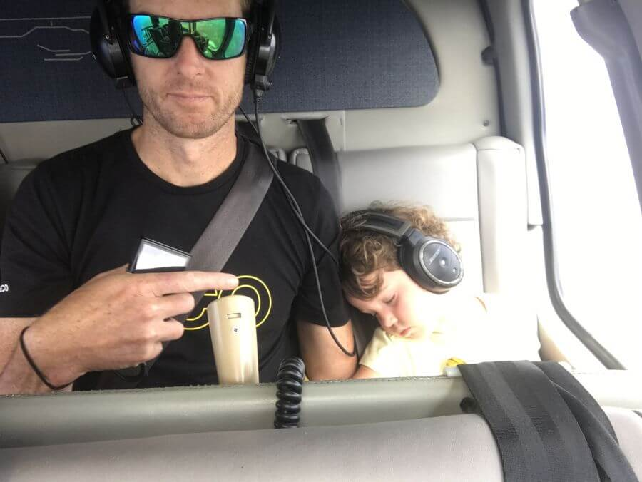 Olive from Hill Tribe Travels asleep on our helicopter flight with Blue Hawaiian review. Hill Tribe Travels explored the Big Island with kids