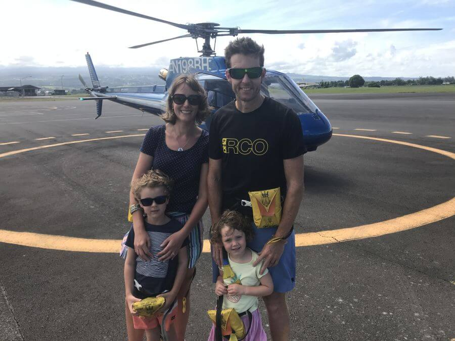 Hill Tribe Travels standing in front of our Blue Hawaiian Helicopter. One of the many activities on The Big Island with kids
