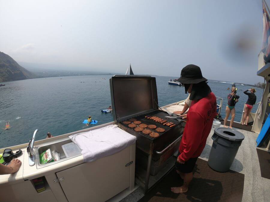 Hill Tribe Travels had a great experience with Fair Wind cruises in Kona, The Big Island, Hawaii, here the staff are cooking the BBQ on the back of the boat