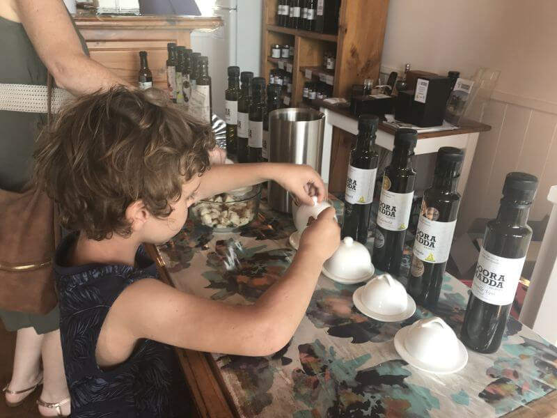 Ned from Hill Tribe Travels olive tastings. Another fun thing to do in Rutherglen with kids