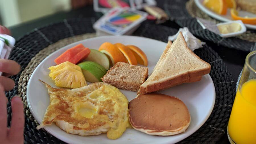 Big breakfast plate at Canopus Retreat. Hill Tribe Travels Review of Canopus Retreats. Maldives local island. Budget Maldives. Huge breakfast.