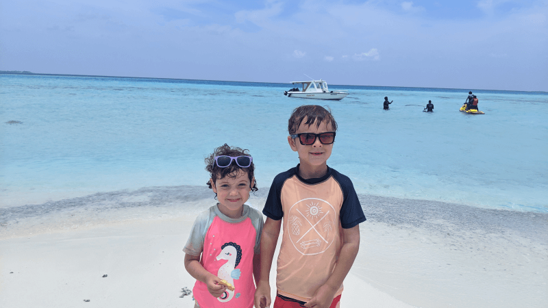 Ned and Olive from Hill Tribe Travels. Enjoying a visit to a sandback not far from Thulusdhoo Island. Budget Maldvies. Family friendly maldives.