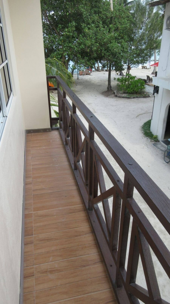 The Balcony for the family room at Canopus Retreat. This is Hill Tribe Travel review of Canopus Retreat. Budget Maldives. Family friendly Maldives. Local island Maldives. Tiny balcony with no room to sit