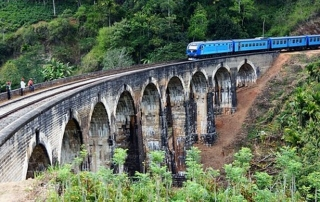 The blue train heading over Nine Arches Bridge. Hill Tribe Travels caught the blue train from Ella to Kandy in Sri Lanka