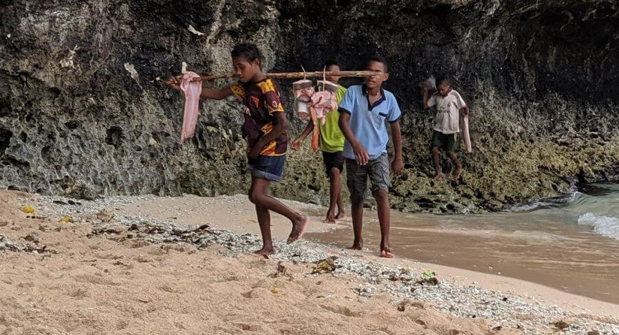 The kids Papua New Guinea caught and cleaned a shark for dinner!