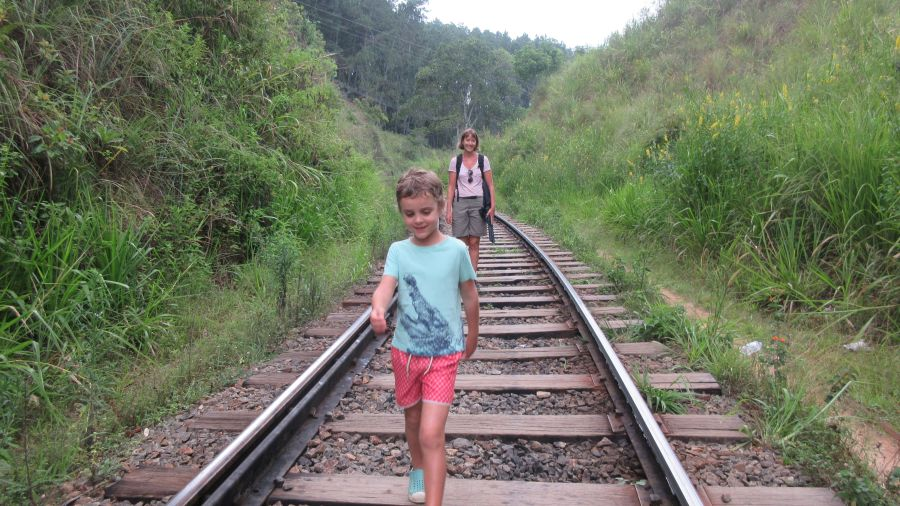 Hill Tribe Travels Sri Lanka Family adventure Sri LAnka with kids This photo is Hill Tribe Travels walking along the train tracks