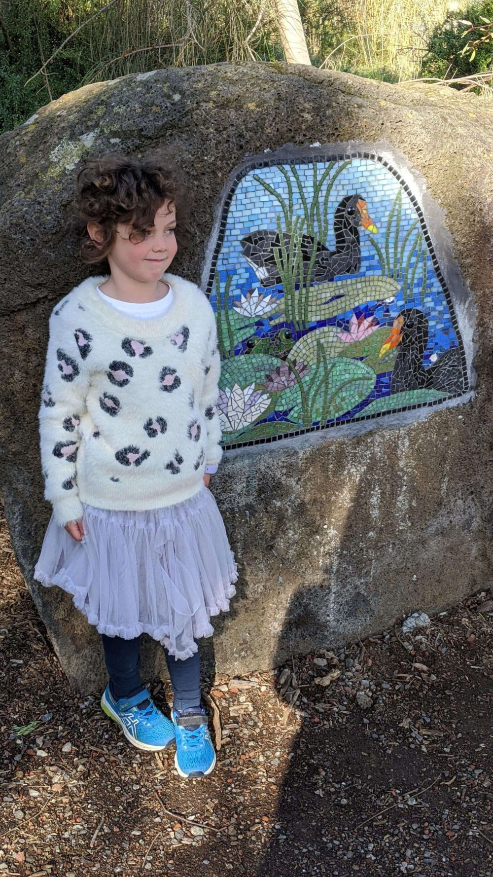 Olive from Hill Tribe Travels enjoying the artwork around Newport Lakes